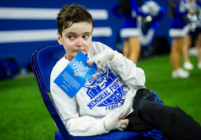 One of Memorial's biggest fans Sam Schulz, 15, watches the Evansville Memorial vs East Noble IHSAA Class 4A State Championship game from the field at Lucas Oil Stadium in Indianapolis, Ind., Saturday, Nov. 30, 2019.  Memorial won the state title in a 21-3 victory over East Noble.