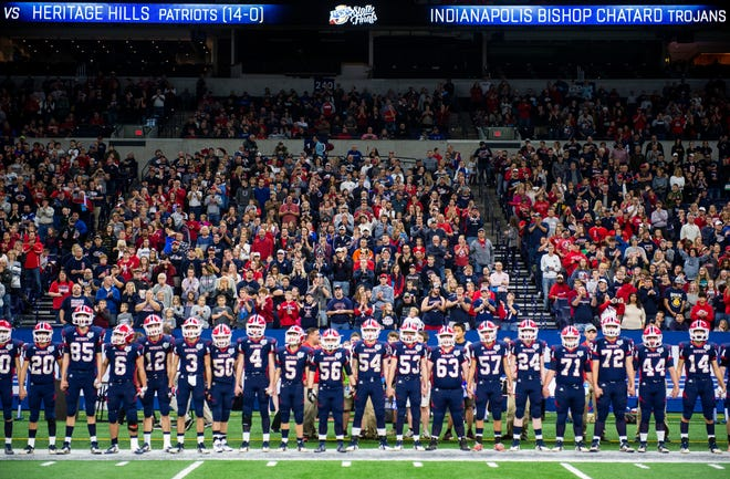 The Patriots line up before the Heritage Hills vs Bishop Chatard IHSAA State Football Game at Lucas Oil Stadium in Indianapolis, Ind., Friday, Nov. 29, 2019.