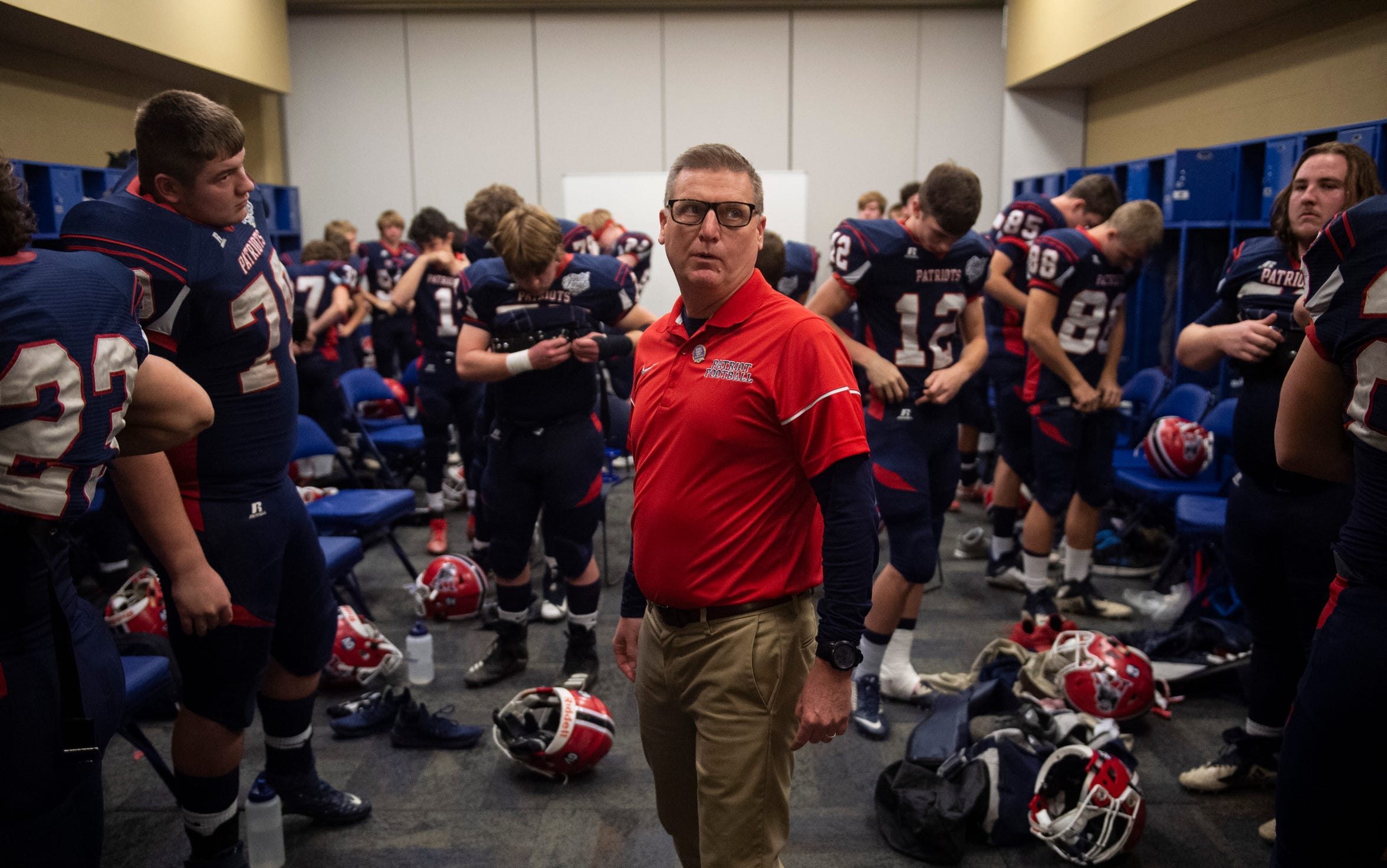 Head coach Todd Wilkerson talks to the Patriots before the Heritage Hills vs Bishop Chatard IHSAA State Football Game at Lucas Oil Stadium in Indianapolis, Ind., Friday, Nov. 29, 2019. Bishop Chatard won 34-3 over No. 2 Heritage Hills.