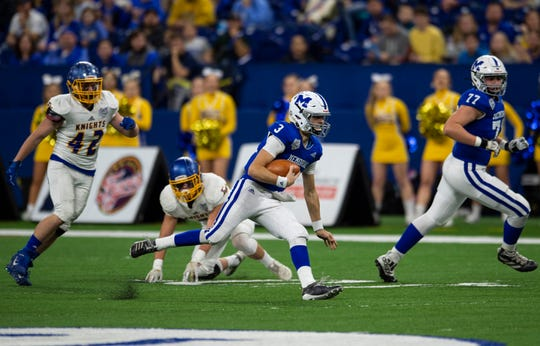 Memorial's Colton Pence (3) runs the ball at the Evansville Memorial vs East Noble IHSAA Class 4A State Championship game at Lucas Oil Stadium in Indianapolis, Ind., Saturday, Nov. 30, 2019.  Memorial won the state title in a 21-3 victory over East Noble.