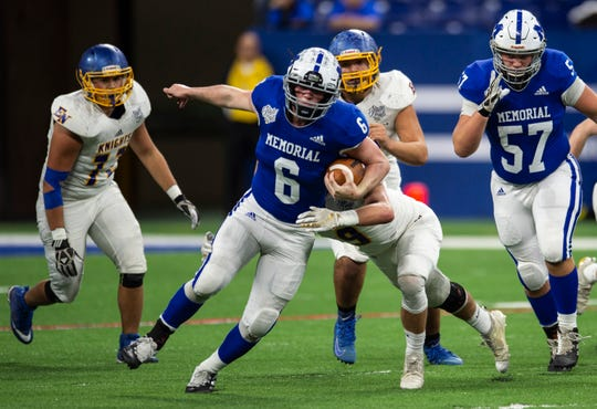 Brock Combs (6), on the move in Memorial's 21-3 victory over East Noble in the Class 4A state championship game, was named Courier & Press All-Metro Player of the Year.