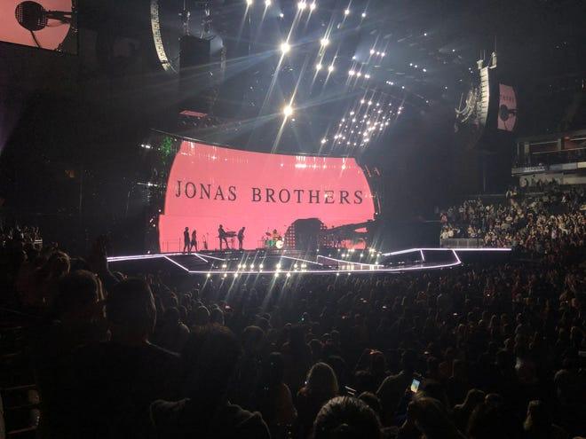 """The Jonas Brothers take the stage to tour their comeback album, """"Happiness Begins."""""""