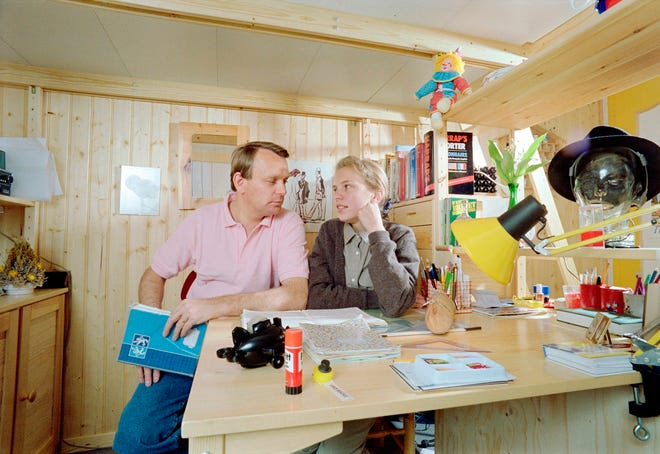 Jean-Marc Ayrault, French mayor of Saint-Herblain and MP of Loire-Atlantique, helps his older daughter Ysabelle Ayrault with her homework, on May 5, 1988 at his home in Saint-Herblain. (Photo by Michel PLASSART / AFP)        (Photo credit should read MICHEL PLASSART/AFP via Getty Images)