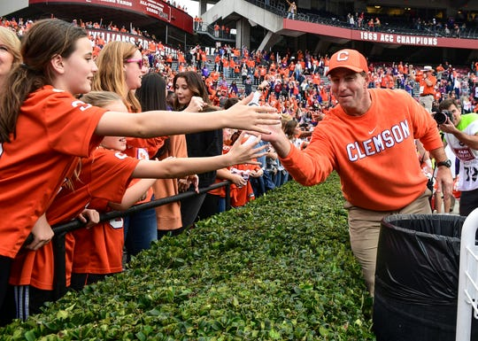 Clemson Head Coach Dabo Swinney greets fans after a 38-3 win over USC at Williams-Brice Stadium in Columbia, South Carolina Saturday, November 30, 2019.