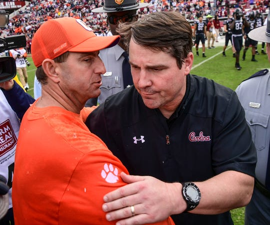 Clemson Head Coach Dabo Swinney shakes hands with South Carolina Head Coach Will Muschamp after a 38-3 win over USC at Williams-Brice Stadium in Columbia, South Carolina Saturday, November 30, 2019.