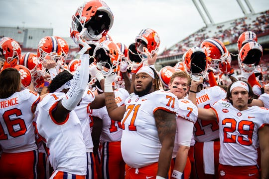 Clemson takes a moment together before their game at the Gamecocks' Williams-Brice Stadium in Columbia, Saturday, November 30, 2019.
