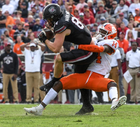 Clemson safety Denzel Johnson(14) tackles South Carolina tight end Kyle Markway(84) during the second quarter at Williams-Brice Stadium in Columbia, South Carolina Saturday, November 30, 2019.