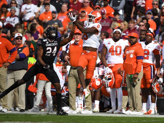 Clemson wide receiver Justyn Ross (8) pulls down a pass over a South Carolina defender on Saturday, Nov. 30, 2019.