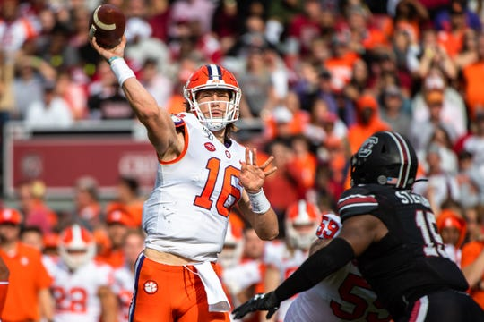 Clemson quarterback Trevor Lawrence (16) makes a pass under pressure during their game at the Gamecocks' Williams-Brice Stadium in Columbia, Saturday, November 30, 2019.