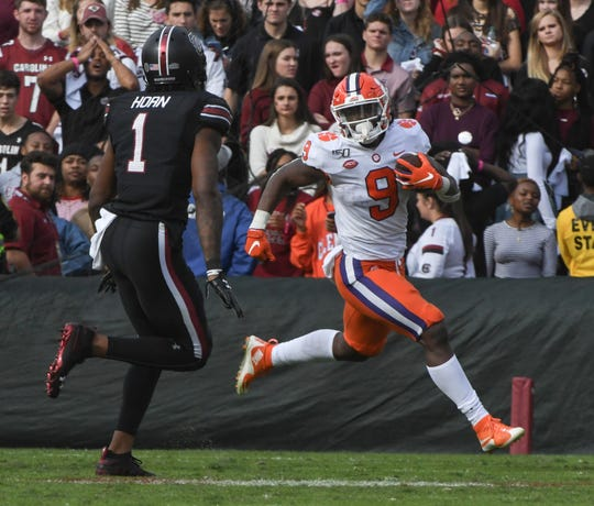 Clemson running back Travis Etienne (9) runs near South Carolina corner back Jaycee Horn(1) during the first quarter at Williams-Brice Stadium in Columbia, South Carolina Saturday, November 30, 2019.