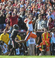 Clemson wide receiver Tee Higgins (5) catches a pass for a touchdown during the first quarter at Williams-Brice Stadium in Columbia, South Carolina Saturday, November 30, 2019.