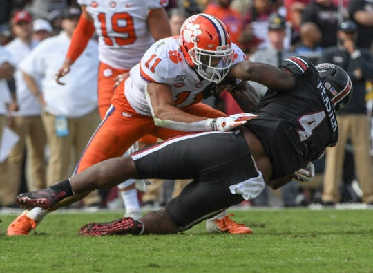 Clemson safety Isaiah Simmons (11) tackles South Carolina running back Tavien Feaster(4) during the first quarter at Williams-Brice Stadium in Columbia, South Carolina Saturday, November 30, 2019.