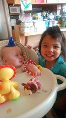 Tony Renova plays with his foster sister, Amelia