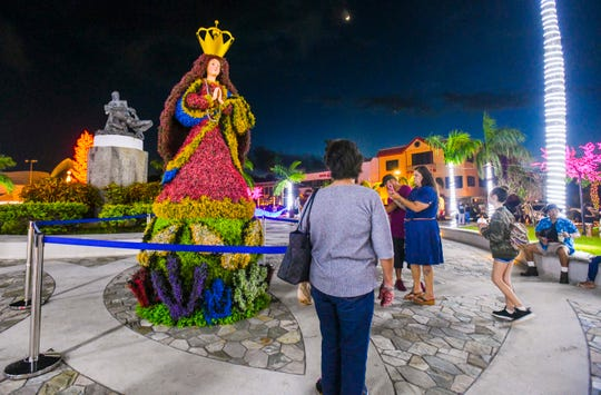 A topiary copy of Santa Maria Kamalen was a favorite among selfies captured during a tree lighting ceremony at Skinner Plaza in Hagåtña on Saturday, Nov. 30, 2019.