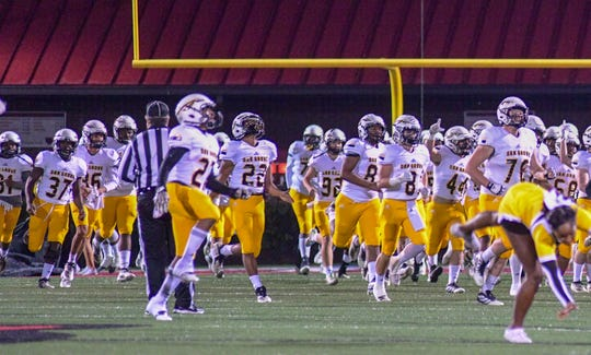 Oak Grove runs out onto Petal's field during their championship game Friday, Nov. 29, 2019
