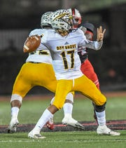 Oak Grove quarterback Damon Stewart looks to make a pass during their championship game against the Petal Panthers Friday, Nov. 29, 2019.