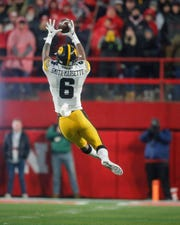 Iowa junior receiver Ihmir Smith-Marsette pulls down a reception late in the fourth quarter against Nebraska on Friday, Nov. 29, 2019, at Memorial Stadium in Lincoln, Neb.