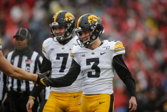 Keith Duncan (3) has celebrated 29 made field goals this season with his holder, Colten Rastetter (7). So when the Iowa kicker was a finalist for the Lou Groza award, he made sure to have Rastetter and long-snapper Jackson Subbert by his side for the ceremony in Atlanta.