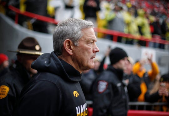 Iowa head football coach Kirk Ferentz leads the Hawkeyes down the tunnel to the field prior to kickoff against Nebraska during their Big 10 final season game on Friday, Nov. 29, 2019, at Memorial Stadium in Lincoln, Neb.