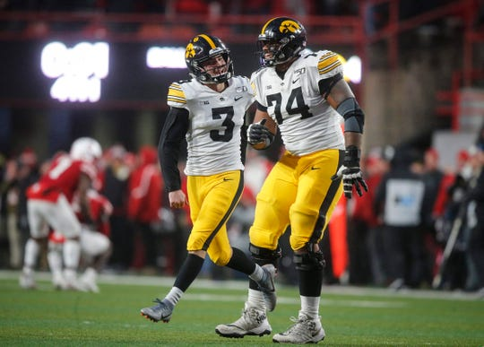 Iowa junior offensive tackle Tristan Wirfs, right, celebrates with place kicker Keith Duncan after Duncan hit a field goal late in the fourth quarter to lead the Hawkeyes over Nebraska on Friday, Nov. 29, 2019, at Memorial Stadium in Lincoln, Neb.