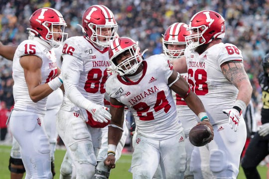 Indiana running back Sampson James (24) celebrates a touchdown against Purdue during the first half of an NCAA college football game in West Lafayette, Ind., Saturday, Nov. 30, 2019. (AP Photo/Michael Conroy)