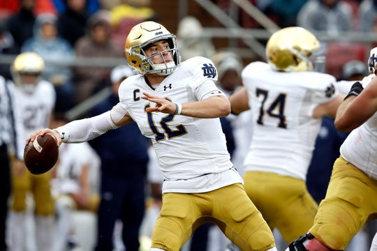 Nov 30, 2019; Stanford, CA, USA; Notre Dame Fighting Irish quarterback Ian Book (12) throws a pass during the second quarter against the Stanford Cardinal at Stanford Stadium.
