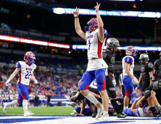 Western Boone Stars Spencer Wright (7) celebrates a touchdown at the IHSAA Class 2A state finals at Lucas Oil Stadium, Saturday, November 30, 2019. Western Boone Stars defeated the Eastbrook Panthers, 44-7.