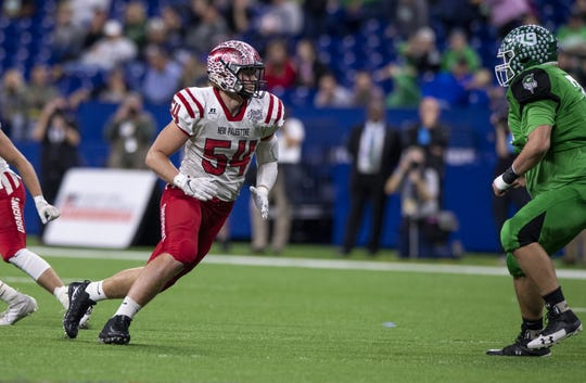 New Palestine High School senior Kyle King (54) during the first half of action in the 47th annual IHSAA class 5A football state finals at Lucas Oil Stadium, Friday, Nov. 29, 2019.