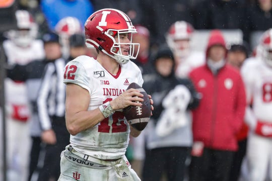 Indiana quarterback Peyton Ramsey (12) throws against Purdue during the first half of an NCAA college football game in West Lafayette, Ind., Saturday, Nov. 30, 2019. (AP Photo/Michael Conroy)