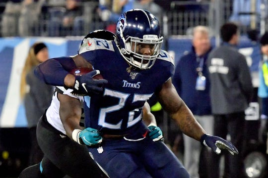 Tennessee Titans running back Derrick Henry (22) rushes against the Jacksonville Jaguars during the second half at Nissan Stadium.