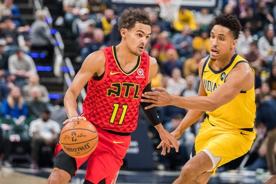 Atlanta Hawks guard Trae Young (11) dribbles the ball while Indiana Pacers guard Malcolm Brogdon (7) defends in the first quarter at Bankers Life Fieldhouse.