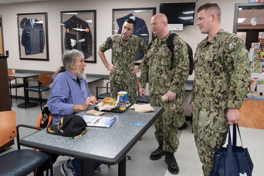 Douglas Bowles speaks with members of the USS Iowa Pre Commission Unit during a visit to the Iowa City VA hospital on Wednesday, Nov. 27, 2019. Five crew-members from the USS Iowa, a Virginia Class submarine currently under construction, visited Iowa in order to familiarize themselves with the state the new submarine will take its name from.