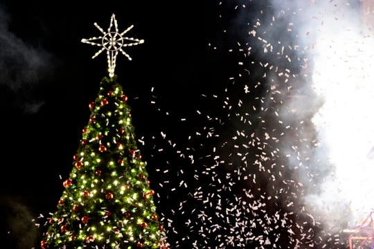 Confetti flies in the air as the Christmas tree is lit at the annual Regal Celebration of Lights in downtown Knoxville, Tenn. on Friday, Nov. 29, 2019.