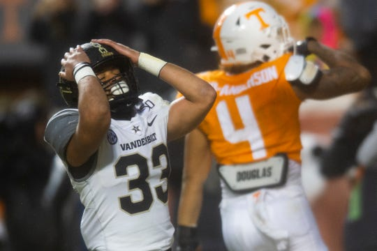 Vanderbilt safety Dashaun Jerkins (33) reacts after Tennessee tight end Dominick Wood-Anderson (4) makes a touchdown during a game between Tennessee and Vanderbilt at Neyland Stadium in Knoxville, Tenn. on Saturday, Nov. 30, 2019.