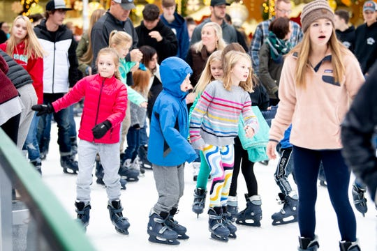 Children ice skate at the annual Regal Celebration of Lights in downtown Knoxville, Tenn. on Friday, Nov. 29, 2019.