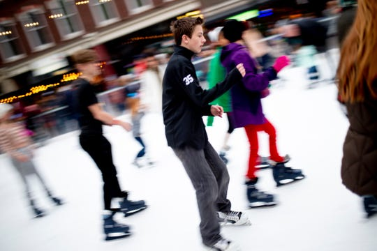 Visitors ice skate in Market Square at the annual Regal Celebration of Lights in downtown Knoxville, Tenn. on Friday, Nov. 29, 2019.