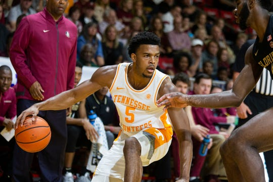 Tennessee guard Josiah-Jordan James (5) controls the ball iagainst Florida State at the Emerald Coast Classic in Niceville, Fla., on Nov. 29, 2019.