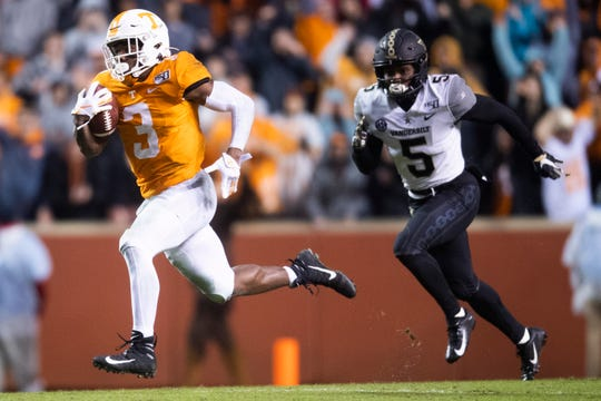Tennessee running back Eric Gray sprints for a 94-yard touchdown in the second quarter at Neyland Stadium in Knoxville on Saturday, Nov. 30, 2019. The freshman had two long scoring runs to propel the Vols to victory against Vanderbilt.