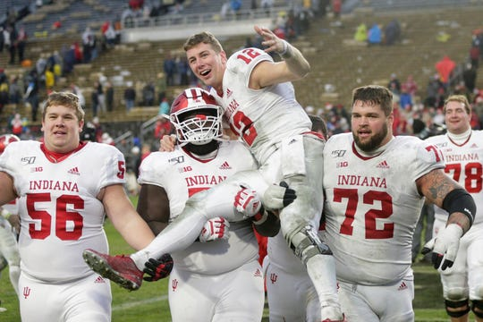 Indiana quarterback Peyton Ramsey (12) is carried across the field after defeating Purdue, 44-41 in double overtime to win the Old Oaken Bucket, Saturday, Nov. 30, 2019 at Ross-Ade Stadium in West Lafayette.