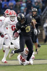 Indiana defensive back Khalil Bryant (29) attempts to stop Purdue wide receiver David Bell (3) during the first quarter of a NCAA football game, Saturday, Nov. 30, 2019 at Ross-Ade Stadium in West Lafayette.