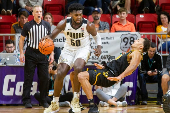 Purdue forward Trevion Williams (50) collides with a Virginia Commonwealth player, and fouls out after being called for charging during the second half of an NCAA college basketball game at the Emerald Coast Classic in Niceville, Fla., Friday, Nov. 29, 2019. Purdue won 59-56. (AP Photo/Mark Wallheiser)