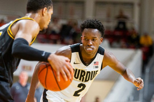 Purdue guard Eric Hunter Jr. (2)  watches the ball as he defends against a Virginia Commonwealth player in the first half of an NCAA college basketball game at the Emerald Coast Classic in Niceville, Fla., Friday, Nov. 29, 2019. (AP Photo/Mark Wallheiser)
