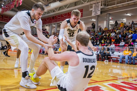 Purdue guard Sasha Stefanovic (55) and center Matt Haarms (32) help up forward Evan Boudreaux (12) after he was fouled during the second half of the team's NCAA college basketball game against Virginia Commonwealth at the Emerald Coast Classic in Niceville, Fla., Friday, Nov. 29, 2019. Purdue won 59-56. (AP Photo/Mark Wallheiser)