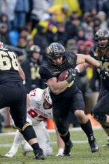 Purdue running back Zander Horvath (40) runs the ball during the fourth quarter of a NCAA football game, Saturday, Nov. 30, 2019 at Ross-Ade Stadium in West Lafayette.