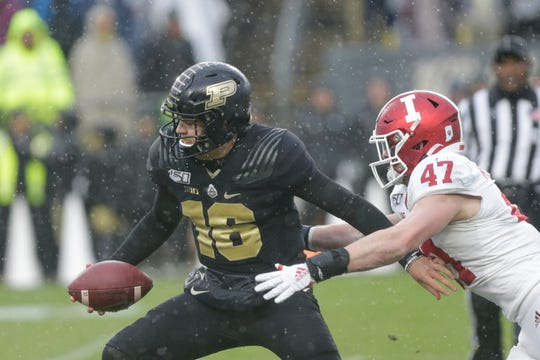 Indiana linebacker Micah McFadden (47) pressures Purdue quarterback Aidan O'Connell (16) during the first quarter of a NCAA football game, Saturday, Nov. 30, 2019 at Ross-Ade Stadium in West Lafayette.