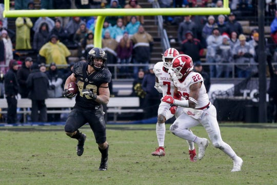 Purdue running back Zander Horvath (40) runs the ball as Indiana defensive back Jamar Johnson (22) comes towards him during the fourth quarter of a NCAA football game, Saturday, Nov. 30, 2019 at Ross-Ade Stadium in West Lafayette.
