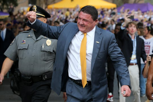 Nov 30, 2019; Baton Rouge, LA, USA; LSU Tigers head coach Ed Orgeron walks down Victory Hill before their game against the Texas A&M Aggies at Tiger Stadium. Mandatory Credit: Chuck Cook-USA TODAY Sports