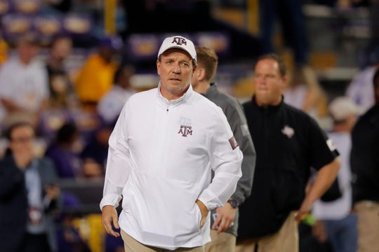 Texas A&M head coach Jimbo Fisher walks on the field before an NCAA college football game against LSU in Baton Rouge, La., Saturday, Nov. 30, 2019. (AP Photo/Gerald Herbert)