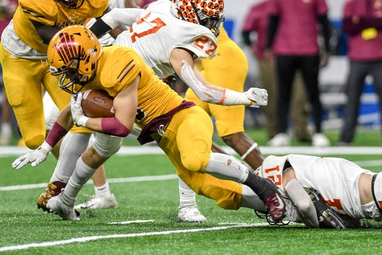 Brighton's Ian Hummel, right, tackles Davison's Carter Cryderman during the first quarter of the Division 1 state football championship on Saturday, Nov. 30, 2019, at Ford Field in Detroit.