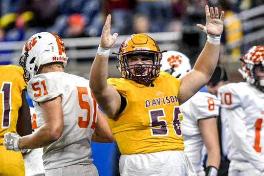 Davison's Lucas Edgar celebrates a touchdown during the second quarter of the Division 1 state football championship on Saturday, Nov. 30, 2019, at Ford Field in Detroit.
